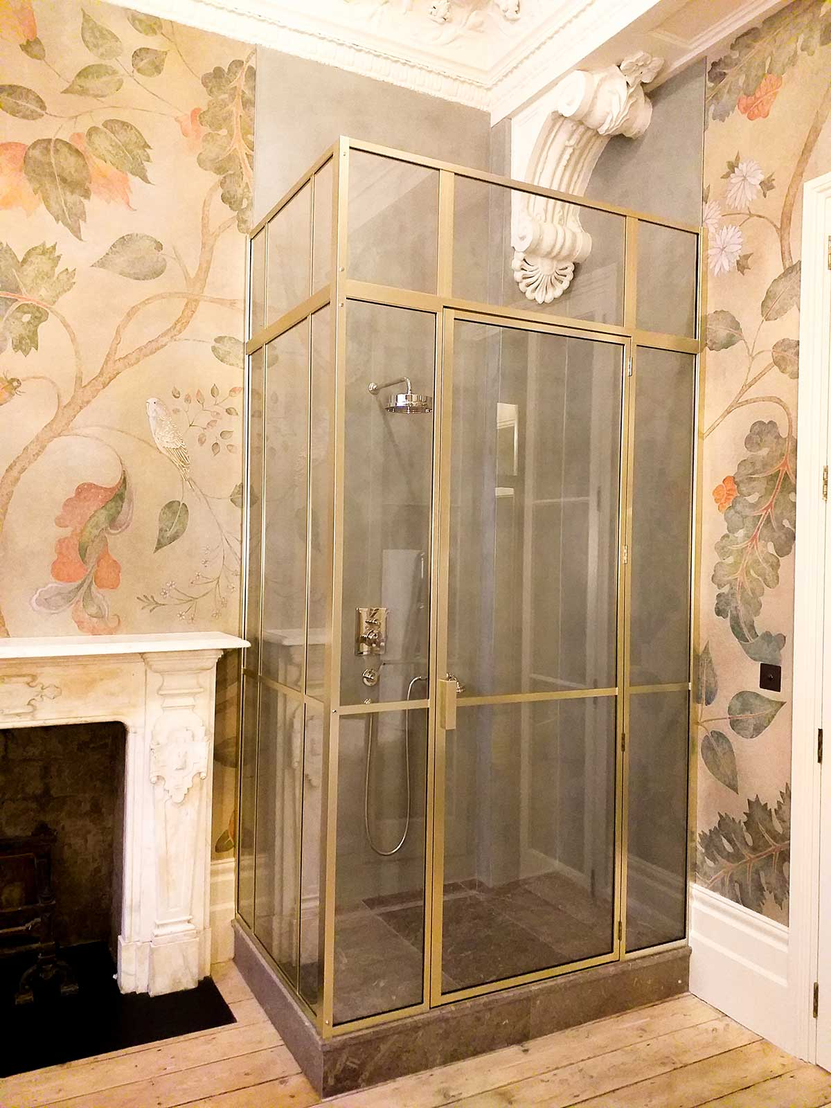 Brushed nickel shower enclosure with transom